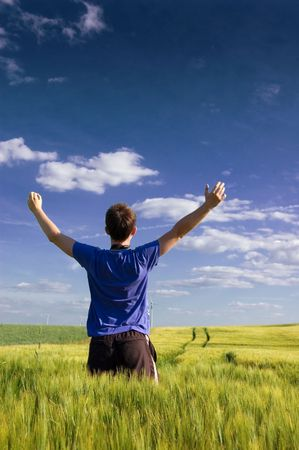 Man standing on the green field at summer and feel the freedom. Stock Photo - 7627059