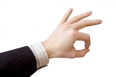 Success in business. Businessman hand shows the sign of victory. photo