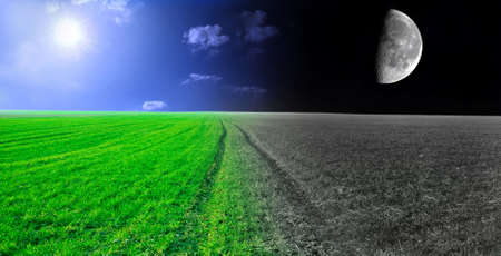 Day and night conceptual image. Green field in day and night. photo