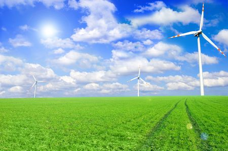 Windmill conceptual image. Windmills on the green field. Stock Photo - 7627695