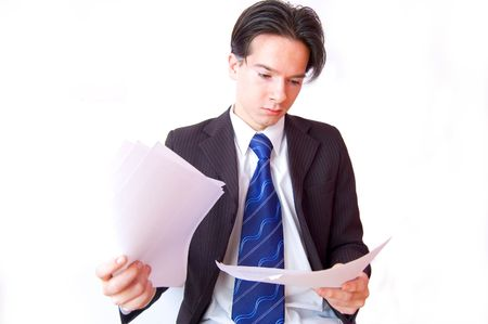 Job conceptual image. Clerk reviews the documents. Stock Photo - 7627047