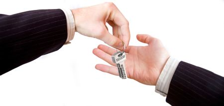Key to success. The businessman is giving the secret of the success to other man. Stock Photo - 7629031