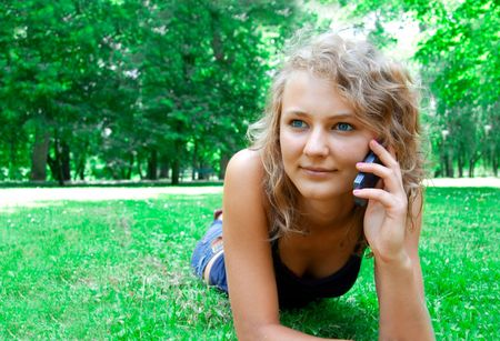 Communication conceptual image. Young beautiful girl talking on a cell phone. Stock Photo - 7627586