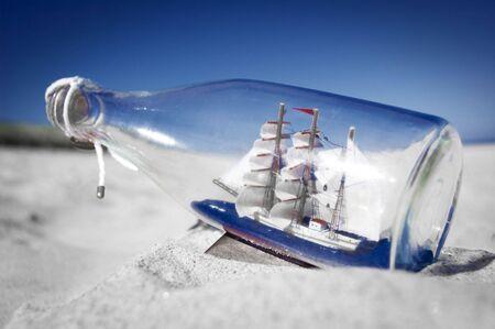 Souvenir conceptual image. Ship in a bottle. Standard-Bild