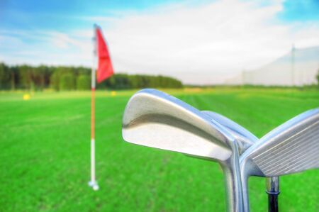 Golf game. Golf clubs against the golf course. Stock Photo - 7629736
