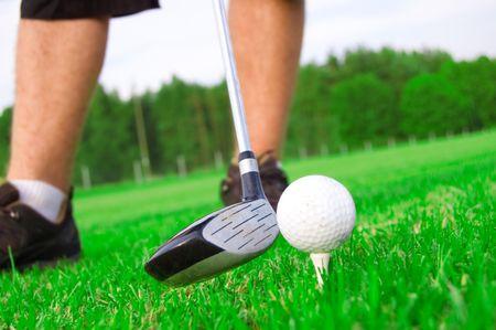 Golf game. Golf player strikes the ball. Stock Photo - 7629769