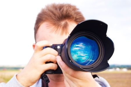 Professional photographer taking pictures. Stock Photo - 7956999