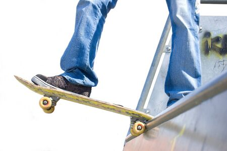 Sport conceptual image. Skateboarder standing on the ramp with skateboard. photo
