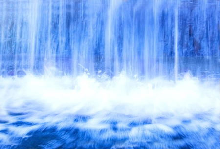 Nature conceptual image. Motion picture of fresh, blue water in waterfall. Stock Photo