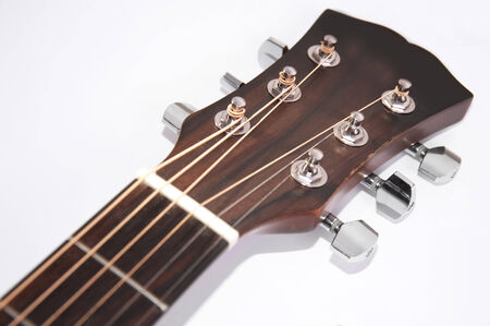single songs: Music conceptual image. Close up of acoustic guitar neck on white background.. Stock Photo