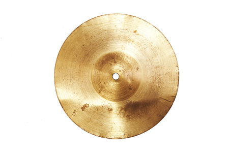 Music conceptual image. Close up of an old cymbal on isolated background.