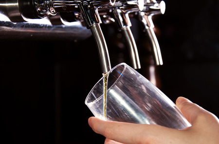 beer pump: Alcohol conceptual image  Bartender giving the beer from dispenser