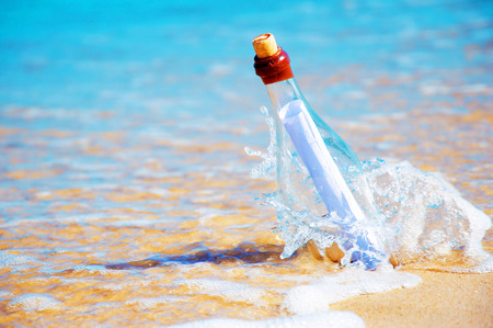 Bottle with a message. Beach and ocean. photo