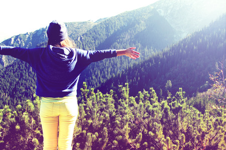 happy teenager: Happy teenage girl feel freedom in mountains scenery. Vintage, retro style.
