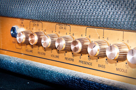 Sound volume controls of vintage guitar amplifier. Music and sound conceptual image. photo