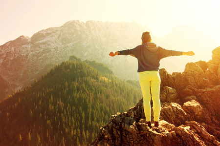 Woman feel freedom in mountains scenery. Freedom conceptual image.