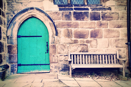 Old doors and bench in creamy pastel vintage picture. photo