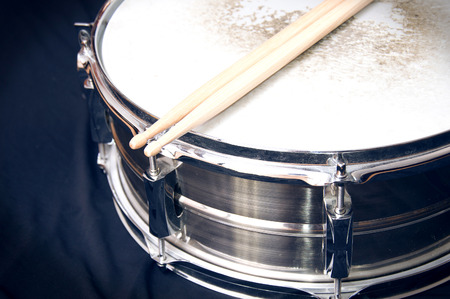snare: Drums conceptual image. Snare drum and stick over black background. Stock Photo