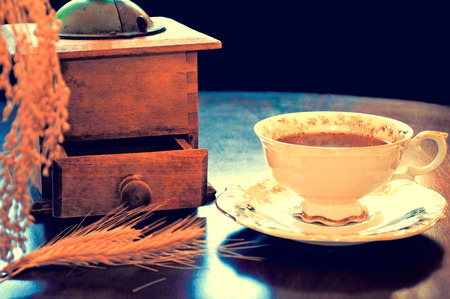 decaffeinated: Food and drinks conceptual image. Antique porcelain cup of decaffeinated coffee on the table. Dark retro vintage picture. Stock Photo
