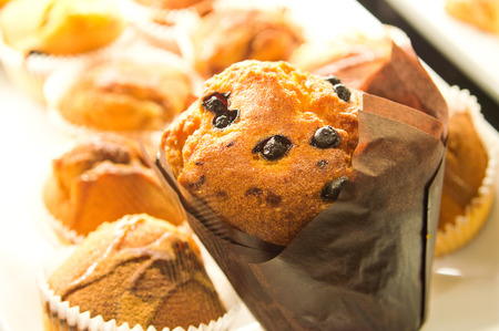 Food conceptual image. Fresh muffins with raisins. photo