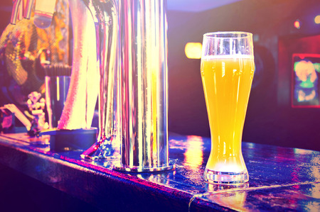 Beer from dispenser. Alcohol conceptual image. Pub. photo
