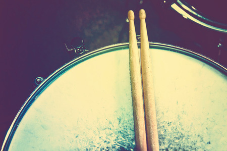 snare: Drums conceptual image. Picture of drums and drumsticks lying on snare drum.