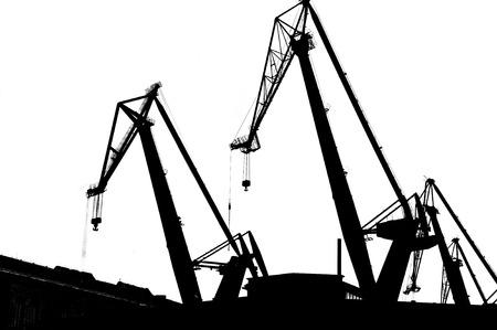 conceptual image: Industrial conceptual image. Black contours of industrial  cranes. Stock Photo