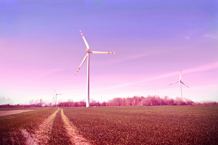 energy picture: Windmills on the field. Vintage instagram picture. Alternative energy. Stock Photo