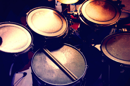 Drums conceptual image. Picture of drums and drumsticks lying on snare drum. Retro vintage  picture.