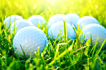 Golf game. Golf balls in grass. Stock Photo