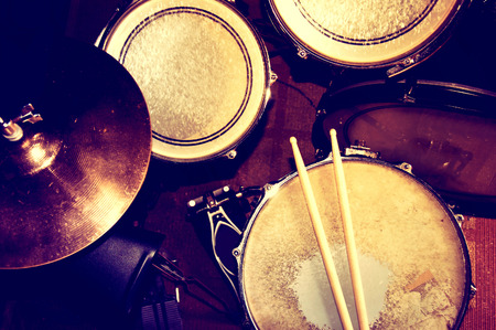 snare: Drums conceptual image. Picture of drums and drumsticks lying on snare drum. Retro vintage instagram picture. Stock Photo