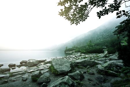 morskie: Fog over lake in mountains. Nature conceptual image. Morskie Oko in Tatry, Poland. Stock Photo