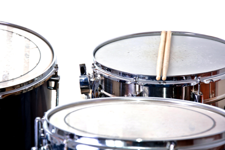 cymbals: Drums over isolated white background. Music conceptual image. Snare toms and cymbals.