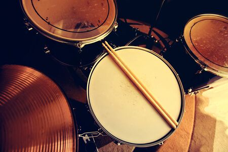 snare drum: Drums conceptual image. Picture of drums and drumsticks lying on snare drum.