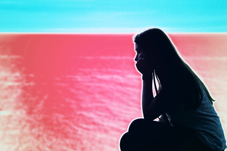 psychodelic: Sad lonely teenage woman over psychodelic background. Mental health conceptual image. Stock Photo