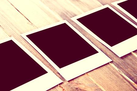 grunge wood: Instant empty polaroid photos frames on wooden background. Free copyspace. Vintage retro concept.