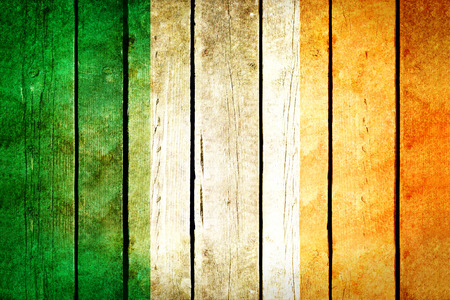 irish culture: Ireland wooden grunge flag. Ireland flag painted on the old wooden planks. Vintage retro picture from my collection of flags.