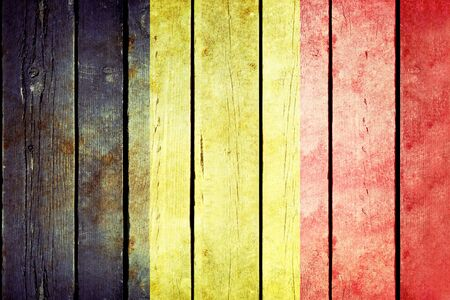 belgium flag: Belgium wooden grunge flag. Belgium flag painted on the old wooden planks. Vintage retro picture from my collection of flags.