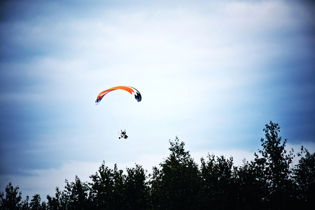 hang glider: Motorized hang glider on the blue sky. Extreme sports conceptual image. Stock Photo