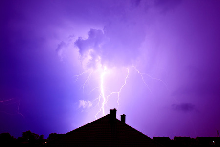 Dramatic sky and storm. Lightning hit the house. Power of nature concept. Standard-Bild