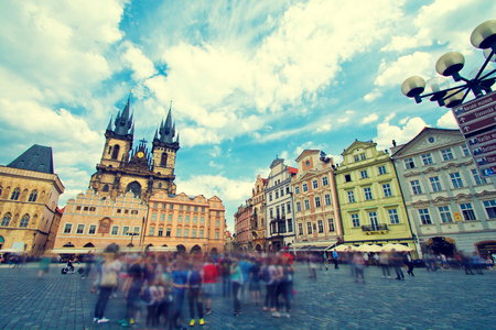 tn: Old town of Prague with crowd of tourists. Church of Our Lady before T?n. Vintage retro picture.