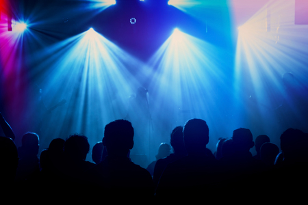 performace: Rock band silhouettes on stage at concert. Abstract image.