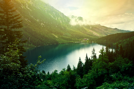 Lake in mountains. Fantasy and colorfull nature landscape. Morskie Oko lake.