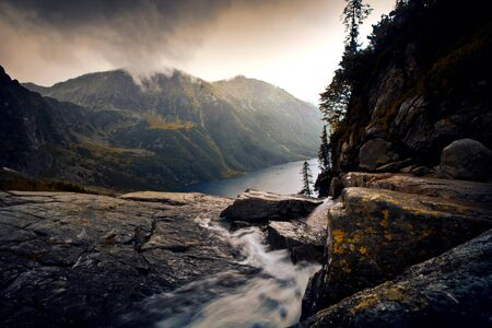 River in foggy mountains landscape. Nature in mountains. Stock Photo