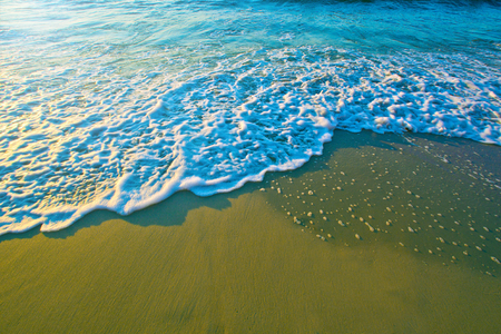 Blue water sea waves on sand in summer. Stock Photo