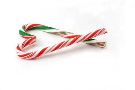 Christmas Candy cane with red and green Bow isolated on white background