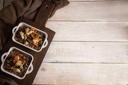 Buckwheat porridge on a wooden white table, top view. Russian national dish Zdjęcie Seryjne