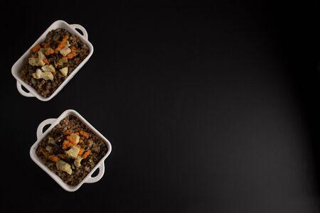 Buckwheat porridge on a dark background, russian national dish, top view