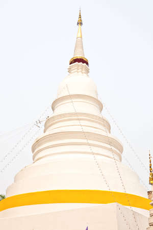 White pagoda with yellow rap  photo