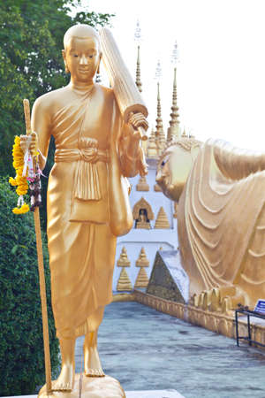 Gold Buddha walking photo